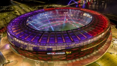 The stadium lit up at night.
