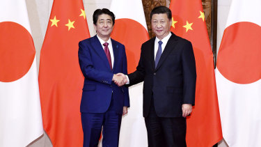 Japanese Prime Minister Shinzo Abe (left) with Chinese President Xi Jinping before a meeting at the Diaoyutai State Guesthouse in Beijing.