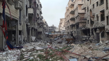 Damaged buildings due to fighting and Syrian government airstrikes in the  eastern Ghouta region of Syria.
