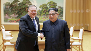 US Secretary of State Mike Pompeo, left, shakes hands with North Korean leader Kim Jong-un during his second visit to North Korea.