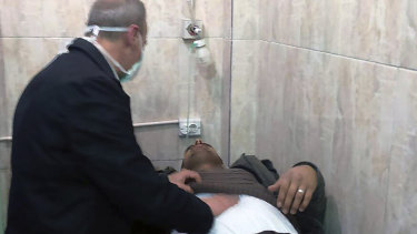 This photo released by the Syrian official news agency SANA, shows a man receiving treatment at a hospital following a suspected chemical attack on his town of al-Khalidiya, in Aleppo, Syria, on Saturday.