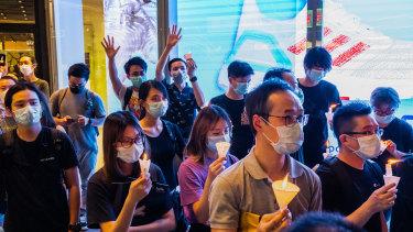 Participants take part in a memorial vigil in a Mongkok in Hong Kong, China.