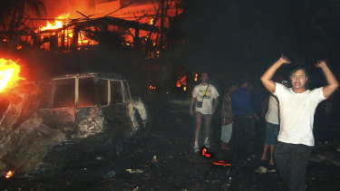 Residents and tourists evacuate the scene of the 2002 bomb blast in Bali, Indonesia. The attack killed 202 people including 88 Australians.