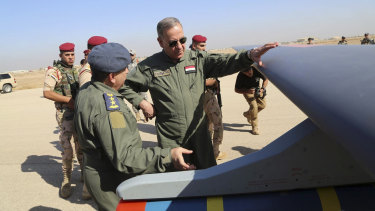 Then Iraqi Defence Minister Khaled al-Obeidi, centre, inspects the first Chinese drone to be used by the Iraqi Air Force before sending it to bomb Islamic State group positions in 2015.