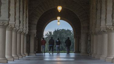 Students walk along the Serra Mall on the campus of California's Stanford University, one of the US tertiary institutions linked to the scam.
