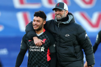 Alex Oxlade-Chamberlain and Jurgen Klopp, manager of Liverpool, celebrate following their team's victory.