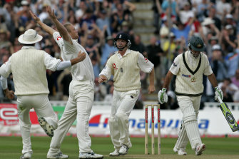 England's Andrew Flintoff celebrates with captain Michael Vaughan, far left, and Ian Bell, third left, after taking the wicket of Australia captain Ricky Ponting at Edgbaston, 2005.