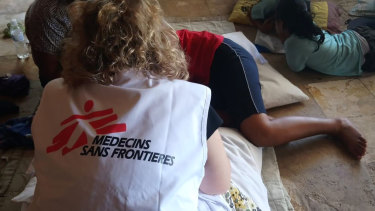 In this October 8, 2018 photo provided by Médecins Sans Frontières Australia, a MSF mental health team attends to a patient in Nauru.