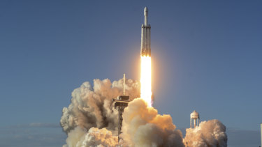 The Falcon Heavy lifts off from pad 39A at the Kennedy Space Center in Cape Canaveral, on Thursday.