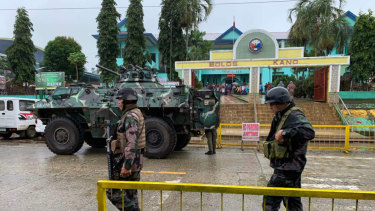 Soldiers walk near an armoured personnel carrier parked outside the Saguiaran city hall in Lanao del Sur province, southern Philippines, during the  referendum on a new autonomous region.
