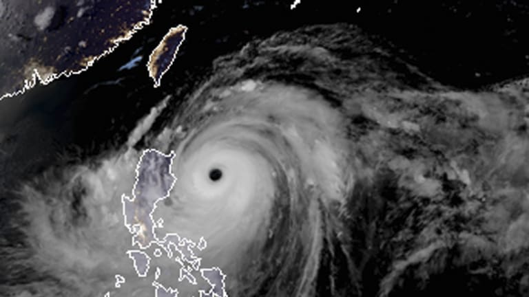 A satellite image with land graphic borders shows the width and trajectory of Typhoon Mangkhut as it approached the Philippines.
