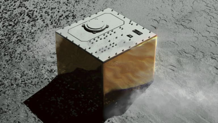 This computer graphic image provided by the Japan Aerospace Exploration Agency (JAXA) shows the Mobile Asteroid Surface Scout, or MASCOT, lander on the asteroid Ryugu. <br> <em> Illustration: JAXA via AP</em>