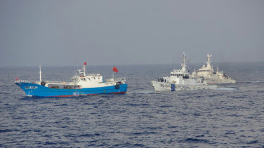 Japan Coast Guard patrol boats approach a Chinese fishing boat, left, in 2013, off the north-eastern coast of Miyako island, about 200 kilometres south-west of the disputed islands called Senkaku in Japan and Diaoyu in China.
