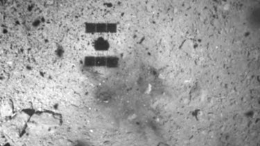 This image released by the Japan Aerospace Exploration Agency (JAXA) shows the shadow of the Hayabusa2 spacecraft after its successful touchdown on the asteroid Ryugu in February.