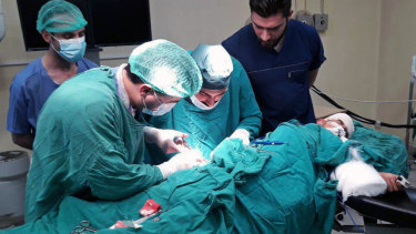 A victim injured by shelling in the town of Suqailabiyah undergoes surgery at a hospital in Hama, Syria, last week.