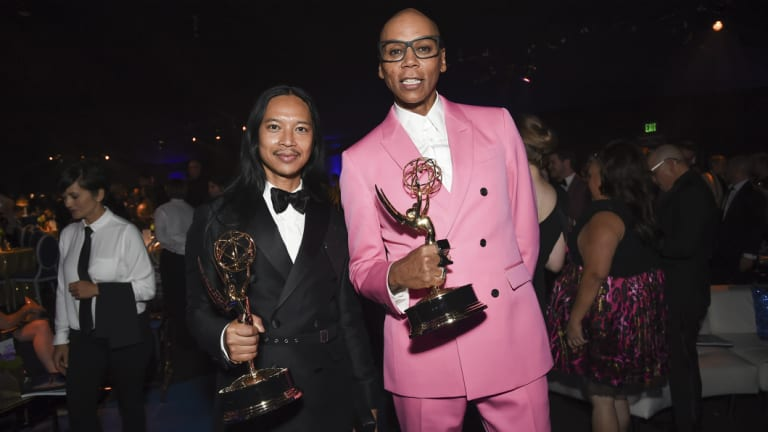 Threepeat: RuPaul Charles, right, has claimed a hat trick of Emmy awards for outstanding host for a reality or reality-competition program.