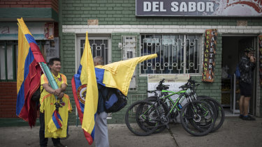 National treasure: Colombian flag vendors wait for costumers at the main square of Bernal's hometown in Zipaquira.