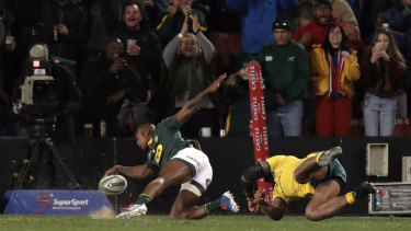 Late lunge: Samu Kerevi can't stop South Africa's S'bu Nkosi scoring in the corner.