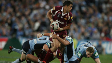 In his prime: Greg Inglis leaves the Blues scrambling in Origin III in 2008.