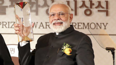 Indian Prime Minister Narendra Modi receives the Seoul Peace Prize during the 14th Seoul Peace Prize award ceremony in Seoul, South Korea, on Friday/