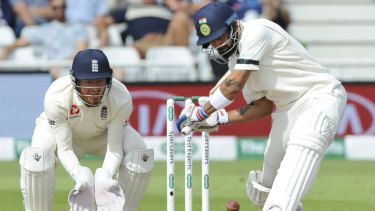 Fine form: Virat Kohli (right) was once again India's leading light with the bat.