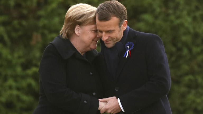 Emmanuel Macron and Angela Merkel unveil a plaque in the Clairiere of Rethondes during a commemoration ceremony for Armistice Day.