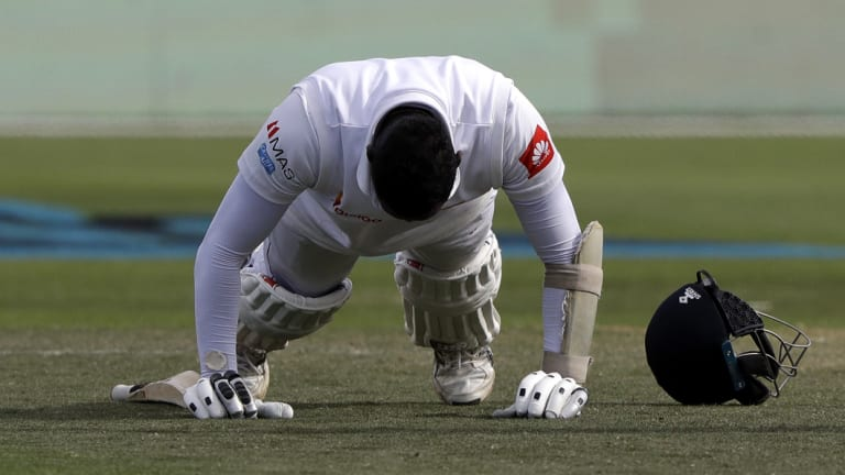 Riposte: Angelo Mathews performs some push-ups after scoring a ton in New Zealand.