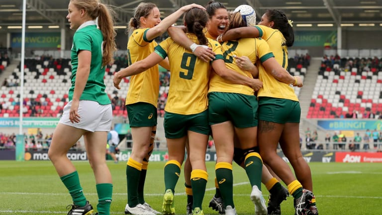 Top win: The Wallaroos embrace after a victory against Ireland in the 2017 Women's World Cup in Dublin.