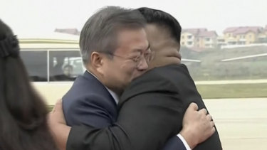 South Korean President Moon Jae-in, left, hugs North Korean leader Kim Jong Un upon arrival in Pyongyang, North Korea, on Tuesday morning.