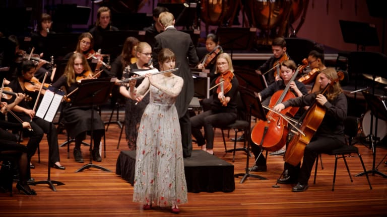 Flautist Serena Ford performs at the Canberra Youth Orchestra concert conducted by Leonard Weiss.