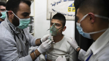 In this photo released by the state-controlled SANA news agency in Syria, a man is said to be receiving oxygen through respirators following an alleged chemical attack on al-Khalidiya, near Aleppo, on Saturday.