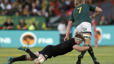 Sidelined: New Zealand's Sam Cane, tackles South Africa's Pieter-Steph du Toit during the Rugby Championship match in Pretoria.