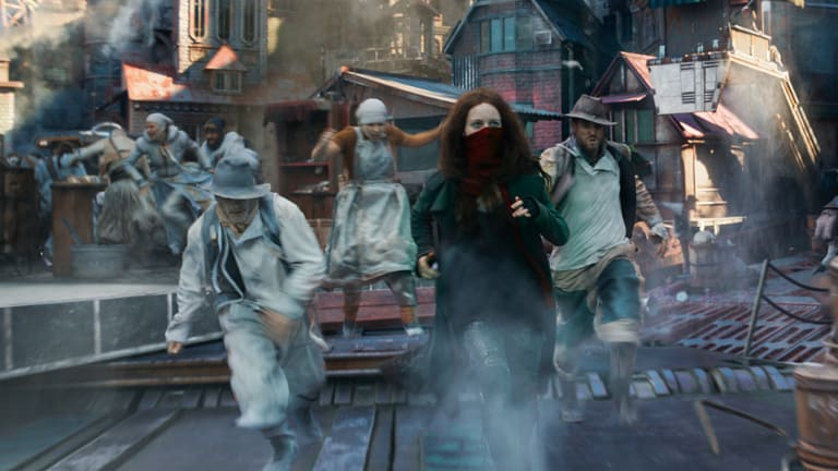 Trying to escape futuristic London on wheels: Hera Hilmar (in mask) as Hester in Mortal Engines.