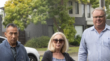 Michael Fong, Sandra MacFarlane and John Muelan, former clients of disgraced tax agent Richard Hogg outside his Cheltenham townhouse.