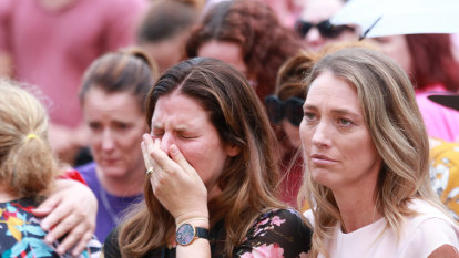 A woman in the crowd sheds a tear at the vigil for Hannah Clarke and her three children Aaliyah, 6, Laianah, 4, and Trey, 3.