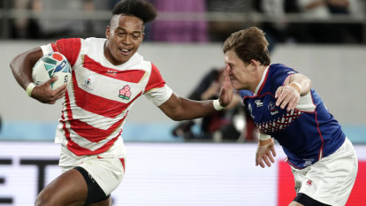 Jittery Japan open Rugby World Cup with scrappy win