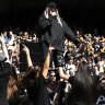 AFL under fire over use of volunteer performers at grand final