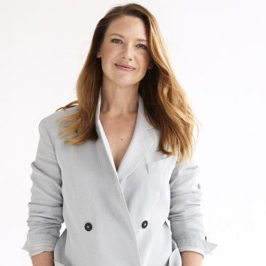 Anna wears Emporio Armani double breasted suit.