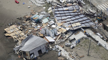 Houses were destroyed at the beachfront area of Miura, south of Tokyo.