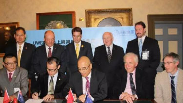 Former MP Daryl Maguire (top row, second from left), Member for Tamworth Kevin Anderson, Jim Harrowell and Jimmy Liu (bottom row centre) at the signing of a beef and aged care investment project agreement in 2017.