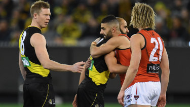 Jack Riewoldt and Dyson Heppell are joined at the coin toss by Bachar Houli and Adam Saad in a show of unity.
