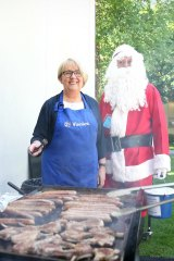 Jenny Macklin with Father Christmas at her annual fundraiser barbeque for the St Vincent De Paul Society.