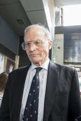 Justice Dyson Heydon leaves the Royal Commission in 2015.