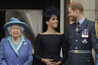 Queen Elizabeth II, with Meghan and Prrince Harry in 2018.