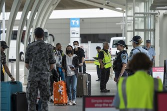 Passengers arriving at Sydney International Airport being transported to hotel quarantine in April.