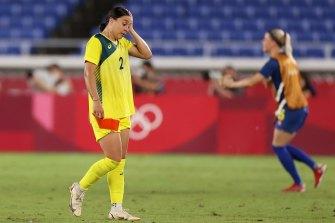 Sam Kerr looks dejected following defeat in the semi-final against Sweden.