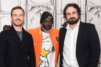Williams with Michael Fassbender, left, and Justin Kurzel in December 2016.