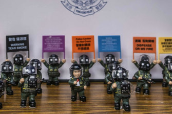 A merchandise table at the Hong Kong Police College in Hong Kong during National Security Education Day.
