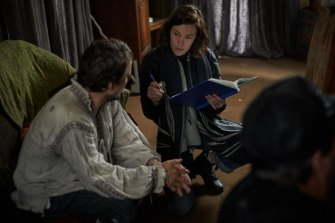 Director Mirrah Foulkes on set with Damon Herriman.