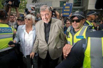 George Pell leaves the County Court in February.